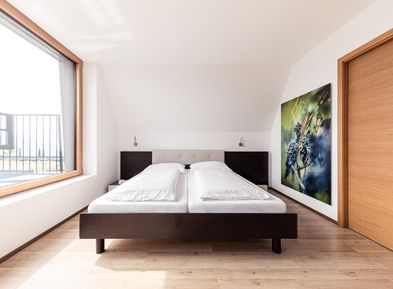 Stylishly furnished bedrooms in the Villa Pernstich in Oltradige