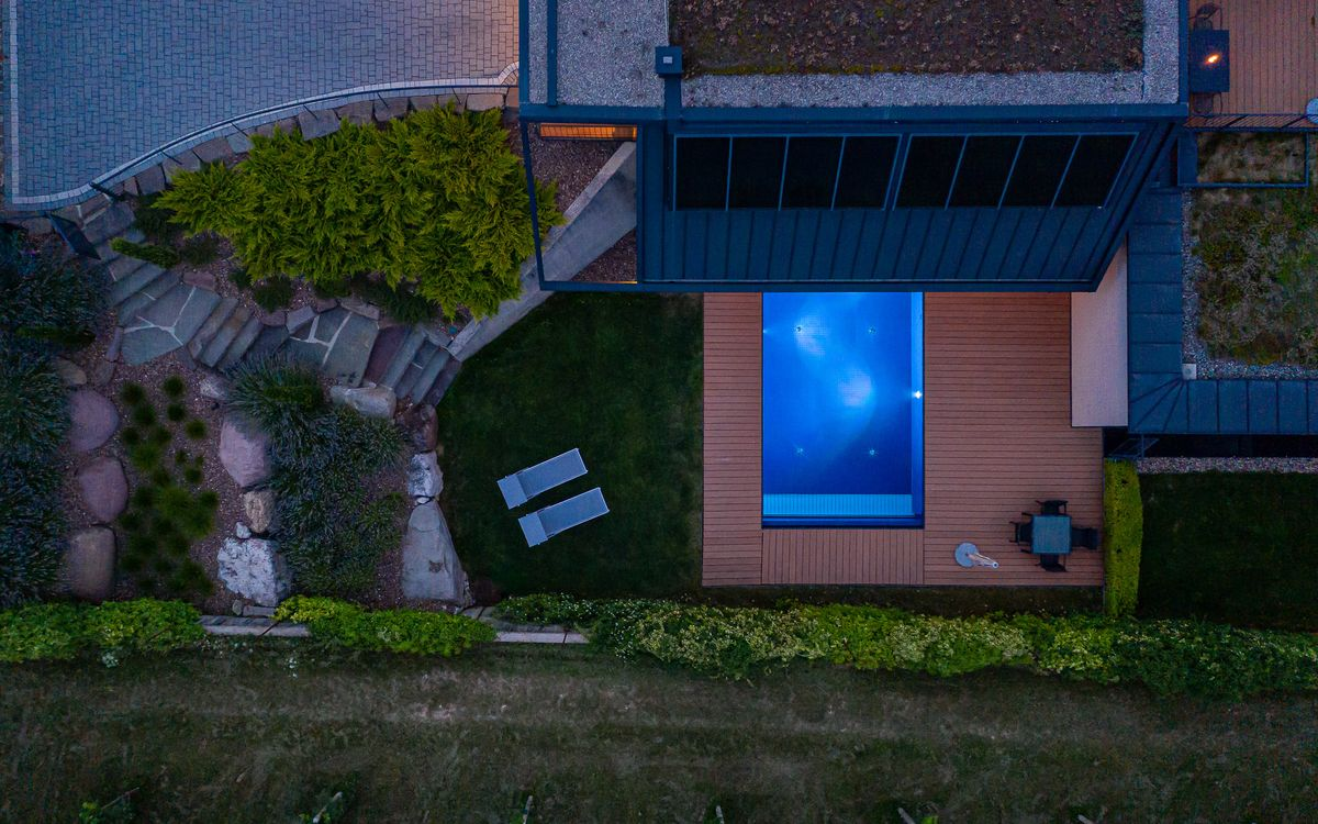 Apartments in passive house - outdoor pool with garden