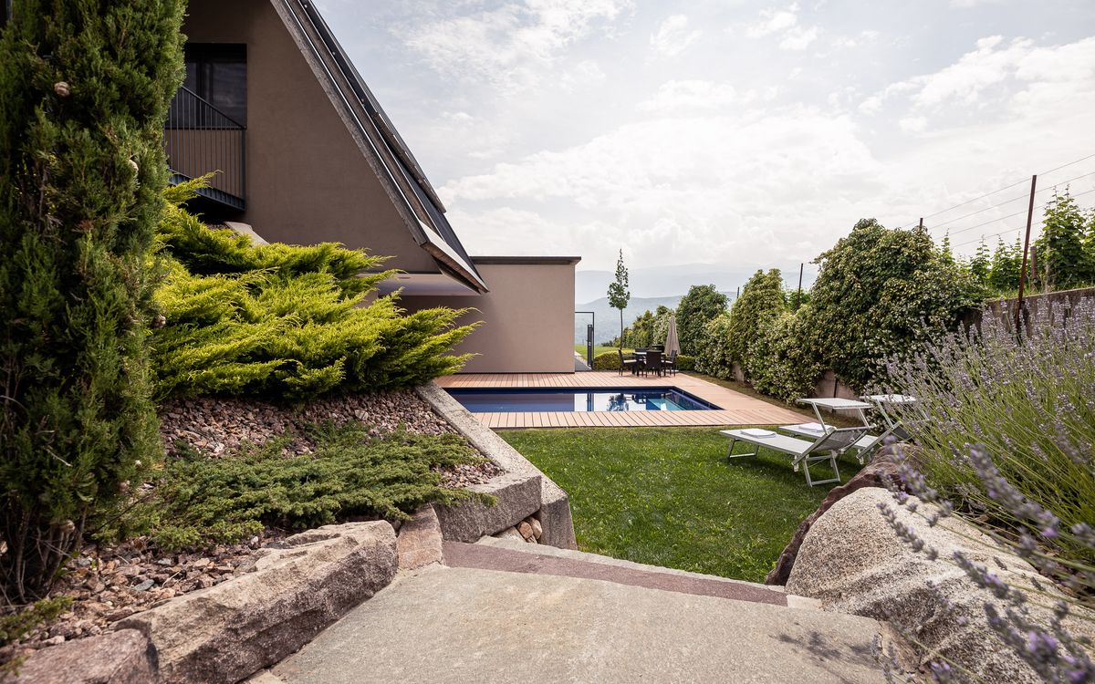 Garden with saltwater pool and lawn in Kaltern, South Tyrol
